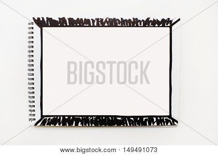 Simple plain background Opened empty notebook page banner with black marker painted abstract frame isolated on white table  Copyspace for text advertising quote Planning concept idea action plan creation