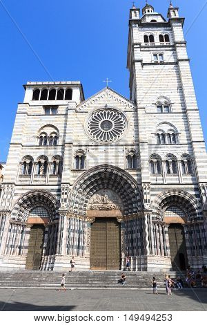 Genoa, Italy - June 26, 2016: West front of  Genoa Cathedral in Liguria. The church is dedicated to Saint Lawrence (San Lorenzo) and is the seat of the Archbishop of Genoa.