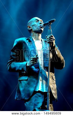 NEWPORT, ISLE OF WIGHT, UK - JUNE 10 2016: Maxi Jazz lead singer of Faithless performing on stage at the Isle of Wight festival in Newport, Isle of Wight