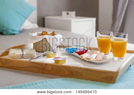 Breakfast tray in bed with delicious food