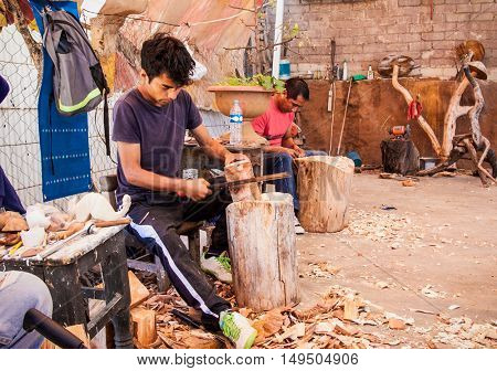 OAXACA, MEXICO-DEC 8, 2015: Unidentified people making a craftsmanship of wood at traditional way on Dec 8, 2015, Oaxaca, Mexico.