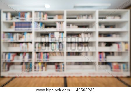 Blurred background of public library bookshelf with books education concept