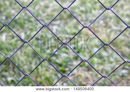 mesh netting galvanized on the background of grass