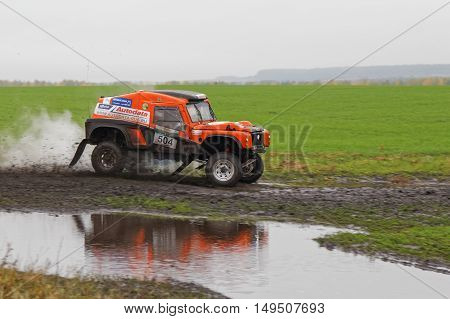 Suv Rally On A Dirt Road Through The Fields
