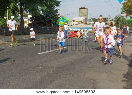 DNEPR ULRAINE - AUGUST 24, 2016: Kids running in Vyshyvanka Run during Independence Day local activity in Dnepr Ukraine at August 24 2016