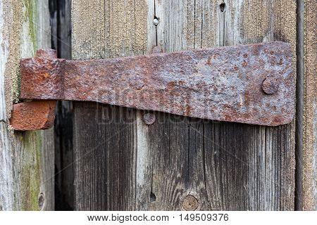 Old rusty hinge on a barn door