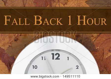 Daylight Savings Time message Some fall leaves and retro silver clock with text Fall Back 1 Hour