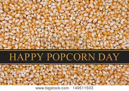 Happy Popcorn Day greeting Popcorn kernels background and text Happy Popcorn Day