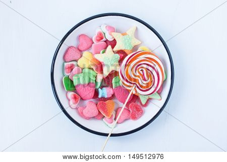 assorted jelly candies on a white background