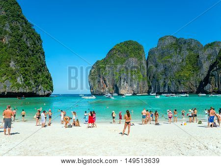 Phi Phi Island, Thailand. December 11, 2014. Tourists on the beach of Maya Bay