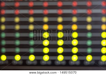 Blurred Audio level LED's indicators. LEDs on photo of multiple colors
