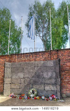 OSWIECIM POLAND - MAY 12 2016: Death Wall in concentration camp Auschwitz-Birkenau in Oswiecim Poland.