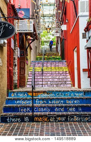 HAMILTON BERMUDA MAY 25 - Colorful steps with sayings in this alleyway on May 25 2016 in the city of Hamilton Bermuda.