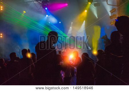 people dancing and having fun at night disco blurred background