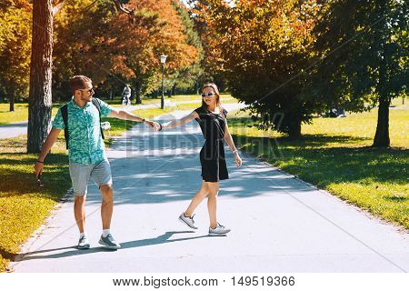 Young Happy Couple In Love Outdoors. Autumn Time In Europe.
