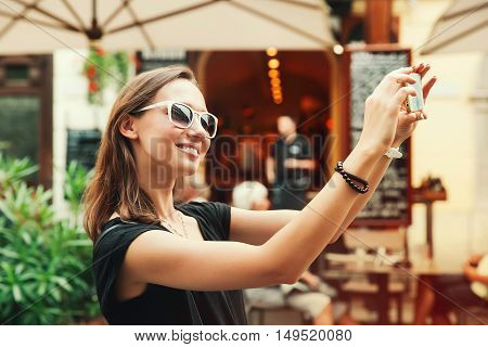 Smiling Tourist On The Background Of Street Cafe. Holidays In European City.