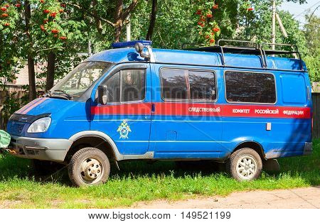 NOVGOROD RUSSIA - AUGUST 6 2016: The car of the Investigative Committee of the Russian Federation parked under the tree in summer day