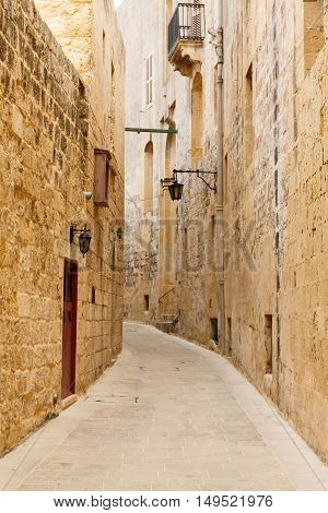 Traditional narrow street in Malta. Maltese architecture in Mdina, Malta