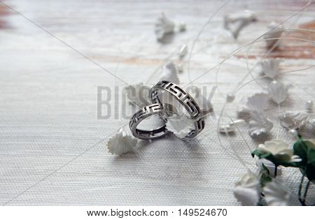 Wedding silver rings on a satiny fabric