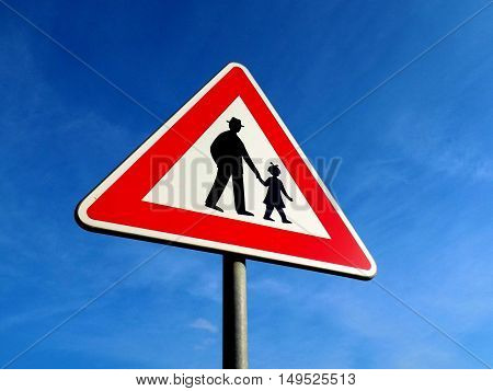 Pedestrians roadsign, parents with child near school, warning traffic sign