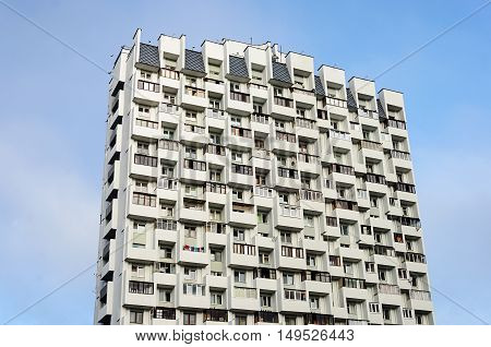 Top of high-rise residential building on blue sky background