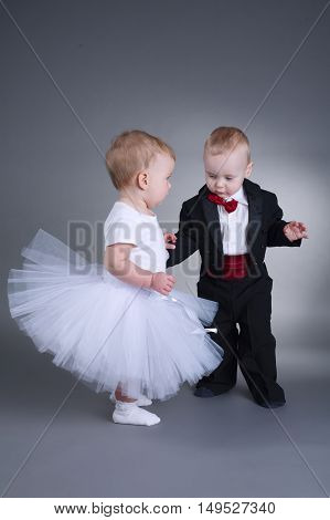 photo of cute boy and girl in wedding dress