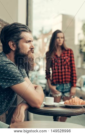 Unhappy Man In Cafe