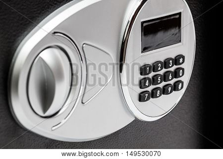 Numeric keypad of safe deposit box close-up protection lock security. poster