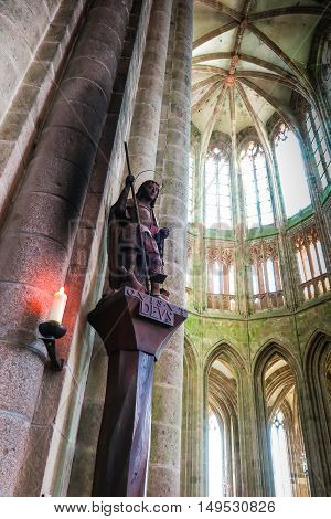 Mont Saint Michel France - September 8 2016 Benedictine Abbey of Mont Saint-Michel in Normandy Archangel Michael with scales and sword