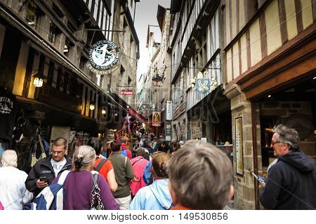 Mont Saint Michel France - September 8 2016: Unidentified tourists in the commercial part of the Mont Saint Michel France