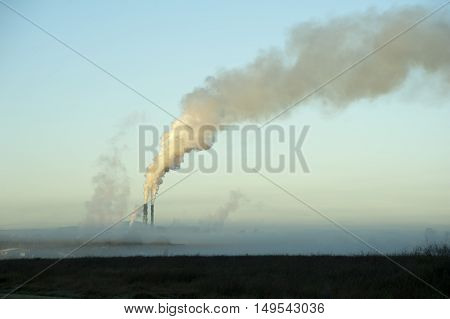 The Proserpine sugar mill Queensland Australia belching steam into the air from its chimneys