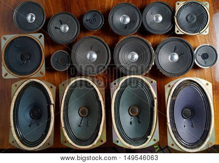 old speakers collection on the wooden table view from above