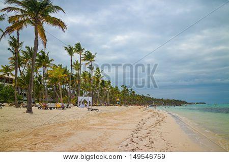 Bavaro beach in Punta Cana Dominican Republic. Beautiful palms and turquoise sea.