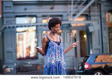 Portrait of fashionable black woman in city street. Photographed in Soho NYC.