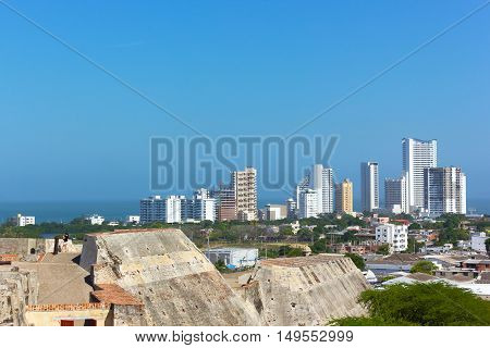 A view on the city from San Filipe de Barajas Castle in Cartagena Colombia. Cartagena skyline and Caribbean Sea on a bright morning.