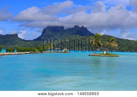 View from Bora Bora airport. Beautiful palms mountains and blue sea. French Polynesia South Pacific Ocean.