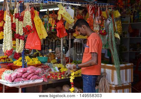 Flower Stall Selling Garlands For Temple Offerings