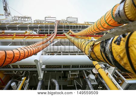 Hose line installed in oil and gas process and purge nitrogen gas into vessel for protected fire case, Offshore construction platform for production oil and gas, Oil and gas industry and hard work.