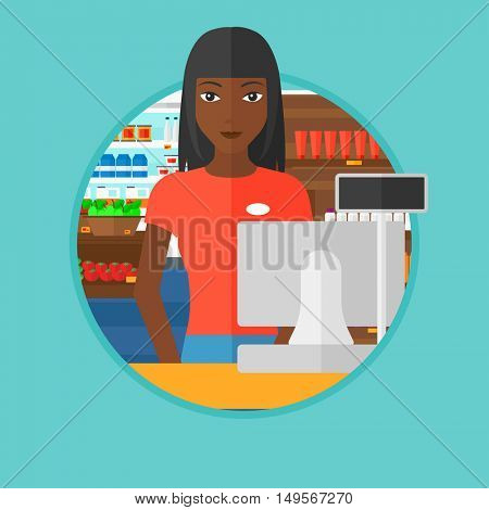 An african-american young cashier standing at the checkout at the supermarket. Cashier working at checkout at the supermarket. Vector flat design illustration in the circle isolated on background.