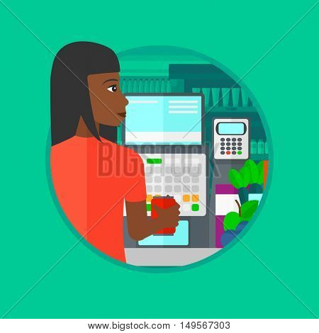 African-american young cashier standing at the checkout at the supermarket. Female cashier working at checkout at the supermarket. Vector flat design illustration in the circle isolated on background.