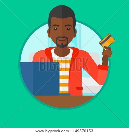 An african man holding a credit card and using laptop for online shopping. Man shopping online at home. Man making online payment. Vector flat design illustration in the circle isolated on background.