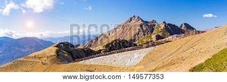 Autumn mountain landscape views of hills and peaks of Caucasus mountains. Krasnaya Polyana - Alpine ski resort constructed from 2003 to 2011 for Sochi games. Rosa Khutor Sochi Russia poster