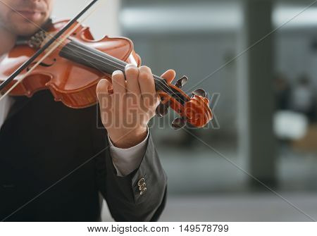 Talented violinist and classical music player solo performance blank copy space on right