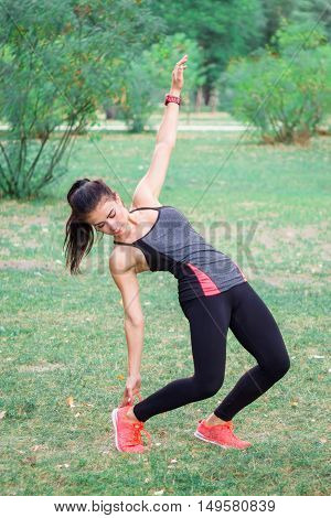 Young Fitness Girl Doing Incline Exercises During Training Workout