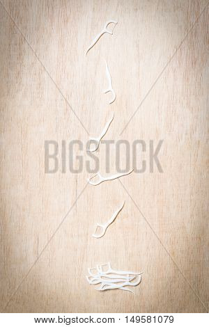 Oral Device : Dental Flossers On Wooden Background
