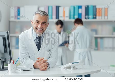 Confident Doctor At The Reception Desk
