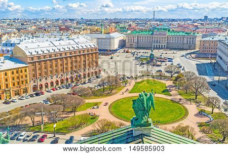 The rooftop of St Isaac's Cathedral is the best place to enjoy the ensemble of St Isaac's Square with green park monument of Tsar Nicholas I Mariinsky Palace historic hotels and mansions St Petersburg Russia. poster