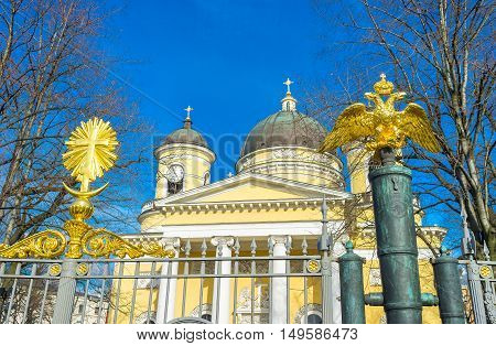 The golden Double-headed Eagle on the bronze barrel next to the central gate to the Transfiguration Cathedral St Petersburg Russia.