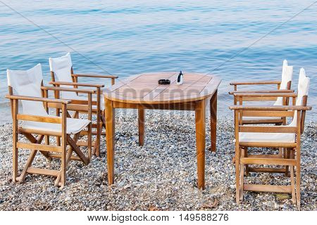 Table and chairs on a beach in Platamonas. Pieria Central Macedonia Greece Europe