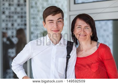 Portrait Of Happy Mather With Son On White Wall,